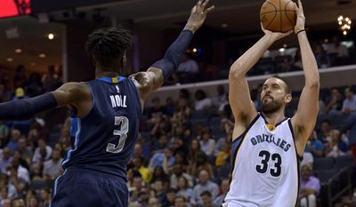 Memphis Grizzlies center Marc Gasol (33) shoots against Dallas Mavericks forward Nerlens Noel (3) in the second half of an NBA basketball game Wednesday, April 12, 2017, in Memphis, Tenn. (AP Photo/Brandon Dill)