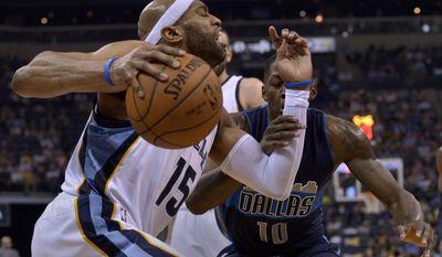 Memphis Grizzlies guard Vince Carter (15) drives against Dallas Mavericks forward Dorian Finney-Smith (10) in the second half of an NBA basketball game Wednesday, April 12, 2017, in Memphis, Tenn. (AP Photo/Brandon Dill)