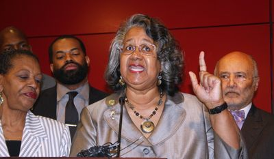 Delegate Cheryl Glenn, a Baltimore Democrat who chairs the Legislative Black Caucus of Maryland, calls for a special session to approve additional licenses to grow medical marijuana to create diversity ownership of businesses in Maryland's developing industry during a Wednesday, April 12, 2017 news conference in Baltimore. State Sen. Joan Carter Conway, D-Baltimore, is standing next to Glenn at left. Attorney Billy Murphy is standing behind Glenn at right, and Del. Nick Mosby, D-Baltimore, is standing behind Glenn at left. (AP Photo/Brian Witte)