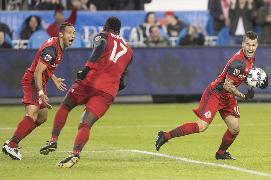 FILE - In this April 8, 2017, file photo, Toronto FC forward Sebastian Giovinco (10), right,  celebrates with teammates Justin Morrow and Jozy Altidore (17) after scoring against Atlanta United FC during the first half of an MLS soccer match, in Toronto. The most interesting of the undefeateds this season is Toronto, which went to the MLS Cup championship last season against the Seattle Sounders. The Reds have one win and four draws, which makes them undefeated but still sitting at ninth in the East.(Chris Young/The Canadian Press via AP, File)