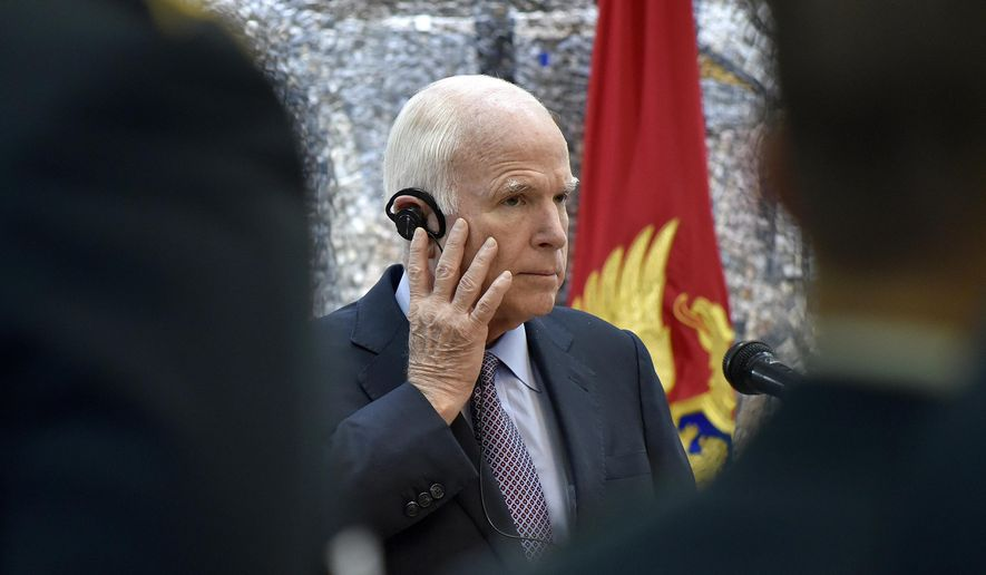 U.S. Sen. John McCain listens to a question during a press conference in Podgorica, Montenegro, Wednesday, April 12, 2017. McCain has congratulated Montenegro for its upcoming NATO membership, blasting Russia for its attempts to interfere in the Balkans. (AP Photo/Risto Bozovic)