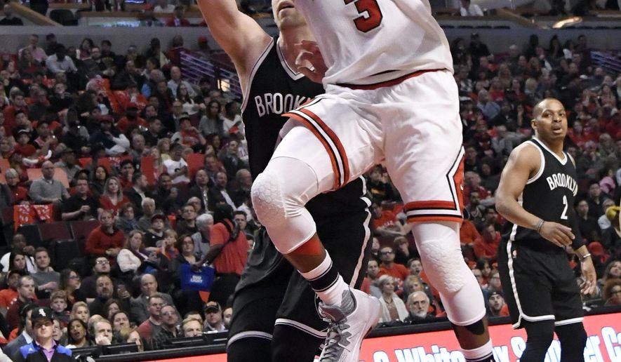 Chicago Bulls guard Dwyane Wade (3) goes to the basket as Brooklyn Nets center Justin Hamilton (41) defends during the first half of an NBA basketball game in Chicago, Wednesday, April 12, 2017. (AP Photo/David Banks)
