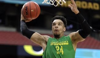 FILE- In this March 31, 2017, file photo, Oregon's Dillon Brooks dunks during a practice session for their NCAA Final Four tournament college basketball semifinal game in Glendale, Ariz. Brooks has announced that he will declare for the NBA draft. (AP Photo/Mark Humphrey, File)