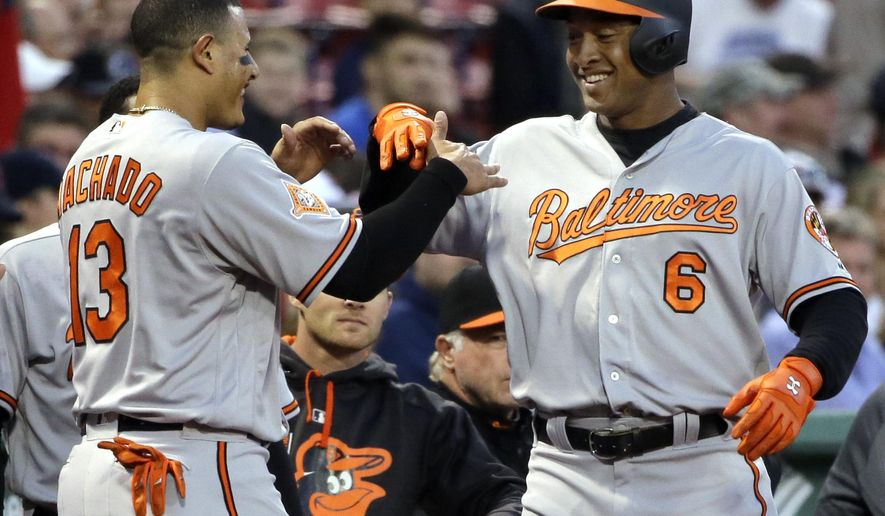 Baltimore Orioles' Jonathan Schoop (6) celebrates his solo home run with Manny Machado (13) during the first inning of a baseball game against the Boston Red Sox at Fenway Park, Wednesday, April 12, 2017, in Boston. (AP Photo/Elise Amendola)