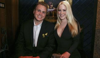 FILE - In this May 13, 2015, file photo, Spencer Pratt, left, and Heidi Montag pose backstage at the 3rd Annual Reality TV Awards at the Avalon Hollywood in Los Angeles. The couple announced in an interview with US Weekly published online on April 12, 2017, that they are expecting their first child. (Photo by Rich Fury/Invision/AP, File)