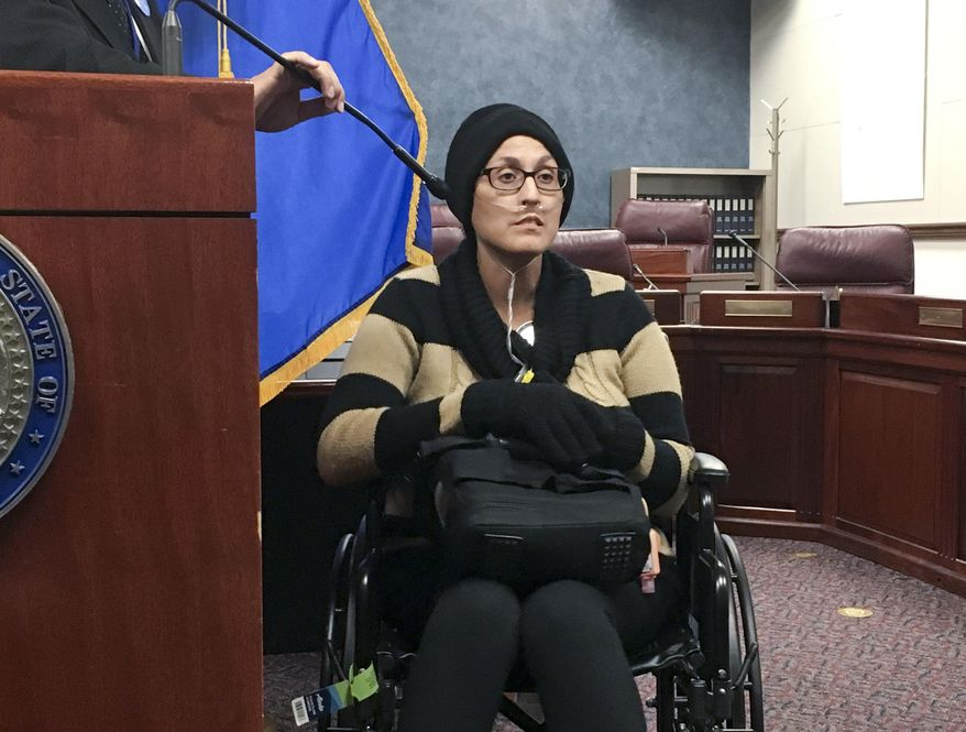 Stephanie Packer, a chronically ill patient, tells reporters she opposes physician-assisted suicide on Wednesday, April 12, 2017, at the Nevada Legislature in Carson City, Nev. She joined doctors and other activists against Senate Bill 261 at a news conference after Democratic lawmakers cancelled a hearing on the proposal that would allow Nevada physicians to prescribe life-ending drugs to patients with prognoses of six months or less to live. (AP Photo/Alison Noon) ** FILE **