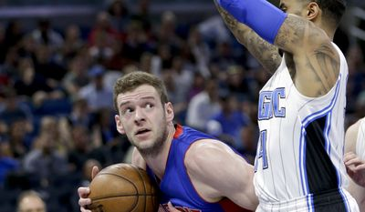 Detroit Pistons' Jon Leuer, left, looks for a way to the basket around Orlando Magic's D.J. Augustin during the first half of an NBA basketball game, Wednesday, April 12, 2017, in Orlando, Fla. (AP Photo/John Raoux)