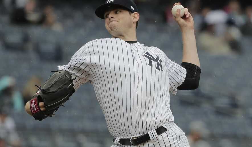 New York Yankees pitcher Jordan Montgomery delivers against the Tampa Bay Rays during the first inning of a baseball game, Wednesday, April 12, 2017, in New York. (AP Photo/Julie Jacobson)