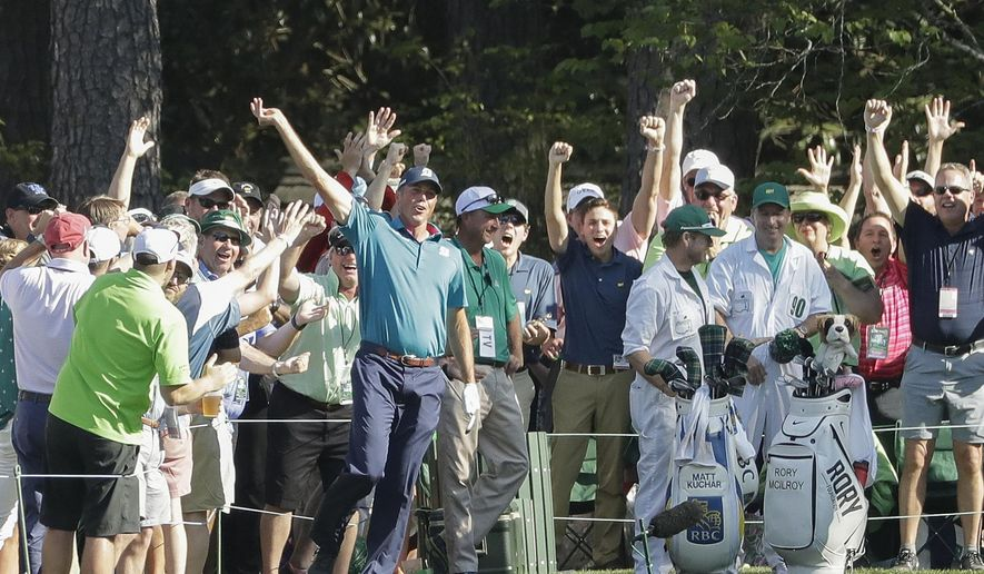 FILE - In this April 9, 2017, file photo, Matt Kuchar reacts after his hole in one on the 16th hole during the final round of the Masters golf tournament, in Augusta, Ga. Kuchar made headlines at the Masters for his Sunday hole in one, his joyous celebration and giveaway of the ball to a young fan and a late charge to fourth at the Masters. He's hoping to carry all of that into the RBC Heritage. (AP Photo/Matt Slocum, File)