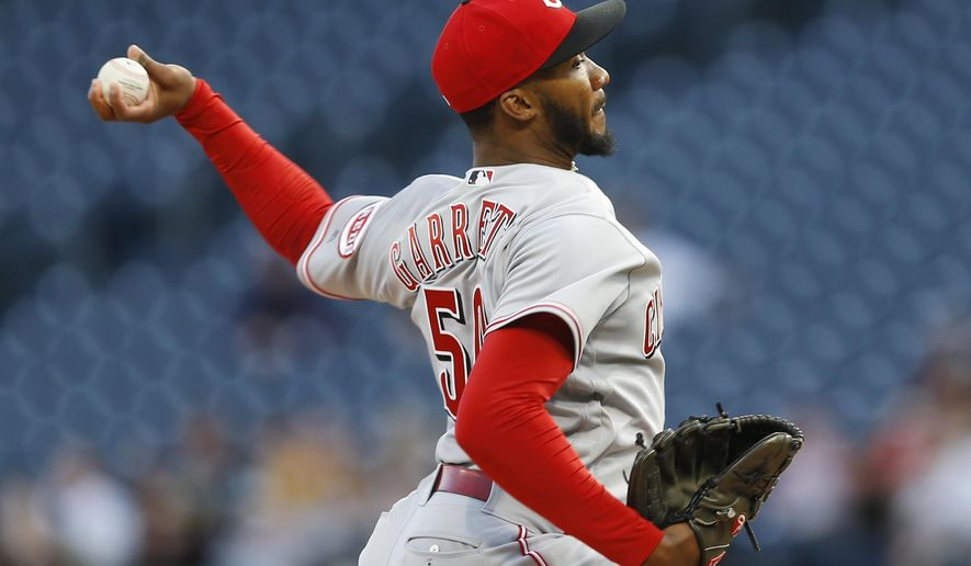 Cincinnati Reds starting pitcher Amir Garrett throws against the Pittsburgh Pirates in the first inning of a baseball game Wednesday, April 12, 2017, in Pittsburgh. (AP Photo/Keith Srakocic)