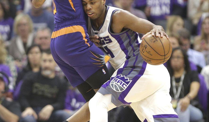 Sacramento Kings guard Buddy Hield, right, runs into Phoenix Suns forward Derrick Jones Jr. during the first half of an NBA basketball game Tuesday, April 11, 2017, in Sacramento, Calif. (AP Photo/Rich Pedroncelli)