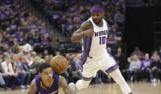 Phoenix Suns guard Tyler Ulis, left, goes to the floor for the ball as Sacramento Kings guard Ty Lawson watches during the first half of an NBA basketball game Tuesday, April 11, 2017, in Sacramento, Calif. (AP Photo/Rich Pedroncelli)