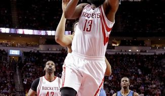 Houston Rockets' James Harden (13) goes up for a shot against the Minnesota Timberwolves during the first half of an NBA basketball game, Wednesday, April 12, 2017, in Houston. (AP Photo/David J. Phillip)