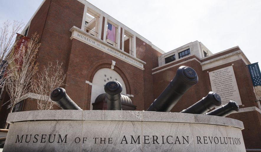 This Monday, April 10, 2017, photo shows the Museum of the American Revolution in Philadelphia. With muskets polished, flags aloft and one very commanding tent in place, the museum is at the ready. After nearly two decades of planning, the museum that tells the dramatic story of the founding of the United States opens in prime historic Philadelphia on April 19. (AP Photo/Matt Rourke)