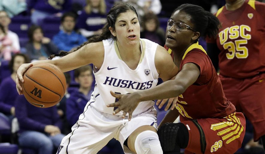 FILE - In this Jan. 17, 2016, file photo, Washington guard Kelsey Plum, left, drives around Southern California forward Temi Fagbenle, second from left, in the first half of an NCAA college basketball game, in Seattle. Plum is expected to be the first pick in the WNBA Draft on Thursday, April 13, 2017. (AP Photo/Ted S. Warren, File)