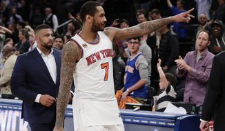 New York Knicks' Carmelo Anthony (7) gestures to fans after an NBA basketball game against the Philadelphia 76ers Wednesday, April 12, 2017, in New York. The Knicks won 114-113. (AP Photo/Frank Franklin II)