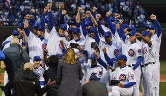 Chicago Cubs' team members celebrate during the 2016 World Series championship ring ceremony before the team's baseball game against the Los Angeles Dodgers on Wednesday, April 12, 2017, in Chicago. (AP Photo/Matt Marton)