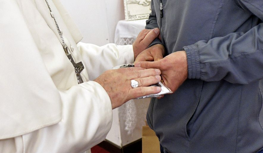 Pope Francis meets an inmate of the Paliano detention center, south of Rome, Thursday, April 13, 2017. Pope Francis heads to a maximum security prison on Holy Thursday to wash the feet of 12 inmates, stressing in a pre-Easter ritual that a pope must serve societys marginalized and give them hope. (L'Osservatore Romano/Pool Photo via AP)