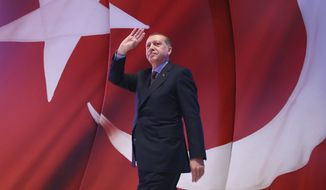 Turkish President Recep Tayyip Erdogan addressed his supporters this week before a contentious referendum Sunday on constitutional reforms to expand his powers. (Associated Press/File)