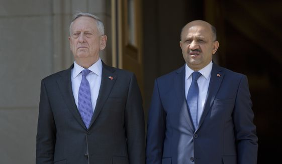 Defense Secretary Jim Mattis, left, and Turkish Defense Minister Fikri Isik participate in an enhanced honor cordon at the Pentagon, Thursday, April 13, 2017. (AP Photo/Pablo Martinez Monsivais)