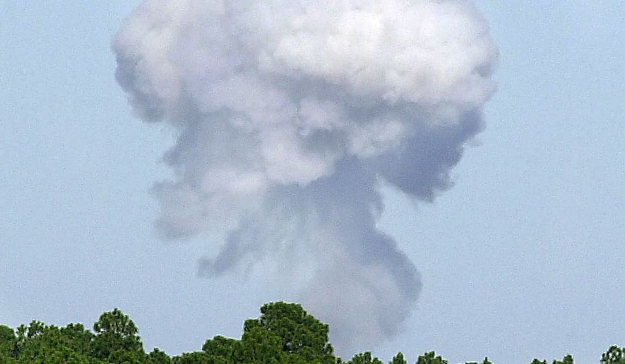 In this May 2004, file photo, a plume of smoke rises over the Eglin Air Force Base reservation in Fort Walton Beach, Fla., during a test of the GBU-43B, or massive ordnance air blast (MOAB) weapon, which contains 11 tons of explosives. U.S. forces in Afghanistan struck an Islamic State tunnel complex in eastern Afghanistan on Thursday, April 13, 2017, with a GBU-43B, the largest non-nuclear weapon ever used in combat by the U.S. military, Pentagon officials said. (Northwest Florida Daily News via AP) ** FILE **
