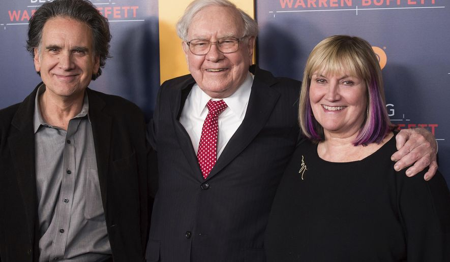 """FILE - In this Thursday, Jan. 19, 2017, file photo, Peter Buffett, from left, Warren Buffett and Susie Buffett attend the world premiere screening of HBO's """"Becoming Warren Buffett"""" at The Museum of Modern Art in New York. A foundation run by Peter, the youngest son of billionaire investor Warren Buffett, is announcing its strategy for distributing $90 million to help improve the lives of young women and girls of color in the United States. The NoVo Foundation was created in 2006 by Jennifer and Peter Buffett. (Photo by Charles Sykes/Invision/AP, File)"""
