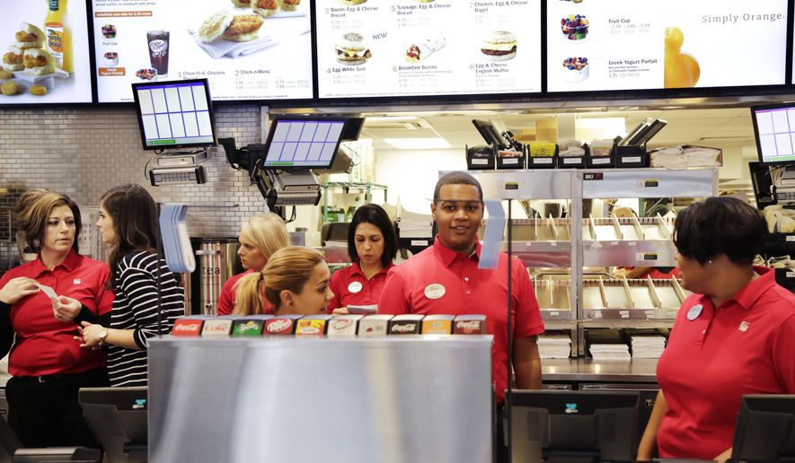 FILE - In this Oct. 1, 2015, file photo, employees familiarize themselves with a new Chick-fil-A restaurant in New York. Donald Trump Jr. mocked a group of Duquense University students on Twitter Thursday, April 13, 2017, for their opposition to the addition of a Chick-fil-A restaurant to their campus. (AP Photo/Mark Lennihan, File)