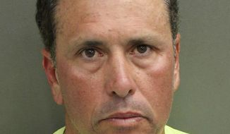 "FILE - This undated photo provided by Orange County Corrections shows Gustavo Falcon, the last of South Florida's ""Cocaine Cowboys"". Falcon was arrested Wednesday, April 12, 2017, some 26 years after he went on the lam, while on a 40-mile bike ride with his wife near the Orlando suburb where they apparently lived under assumed names. Gustavo Falcon, 55, also known as Taby, was booked into the Orlando County jail, Wednesday. He is scheduled to have his first appearance in Orlando federal court on Thursday, before his expected transfer to Miami. (Orange County Corrections via AP)"