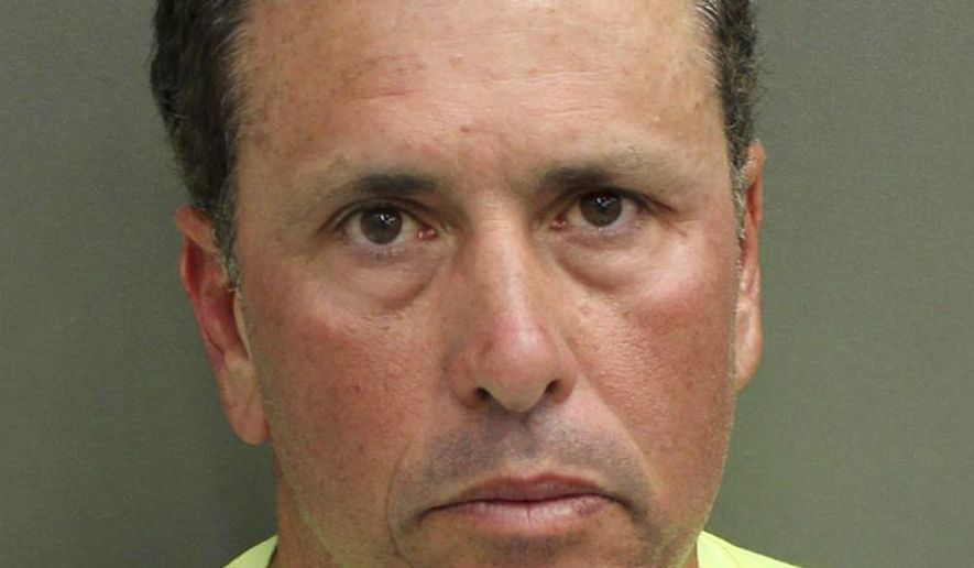 """FILE - This undated photo provided by Orange County Corrections shows Gustavo Falcon, the last of South Florida's """"Cocaine Cowboys"""". Falcon was arrested Wednesday, April 12, 2017, some 26 years after he went on the lam, while on a 40-mile bike ride with his wife near the Orlando suburb where they apparently lived under assumed names. Gustavo Falcon, 55, also known as Taby, was booked into the Orlando County jail, Wednesday. He is scheduled to have his first appearance in Orlando federal court on Thursday, before his expected transfer to Miami. (Orange County Corrections via AP)"""