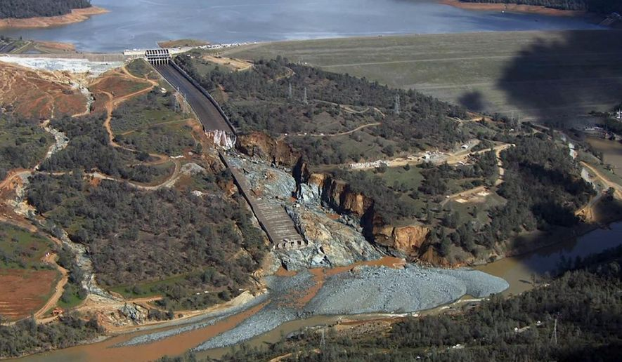 FILE - This Feb. 27, 2017, file image provided by KCRA shows Oroville Dam's crippled spillway in Oroville, Calif. With stormy weather approaching, California plans to resume releasing water down the damaged spillway at the nation's tallest dam.(KCRA via AP, File)