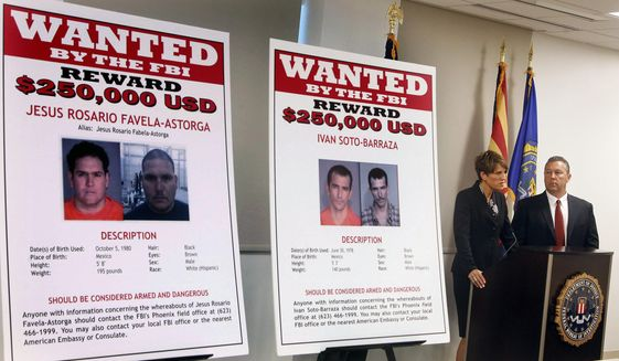 FILE - In this July 9, 2012, file photo, with wanted posters off to the side, Laura E. Duffy, United States Attorney Southern District of California, and FBI Special Agent in Charge, James L. Turgal, Jr., right, announce the indictments on five suspects involved in the death of U.S. Border Patrol agent Brian Terry in Tucson, Ariz. Mexican authorities have arrested the suspected shooter in the 2010 killing of Terry, whose death exposed a bungled gun-tracking operation by the federal government. In a joint statement issued by Mexico's navy and its federal Attorney General's Office on Thursday, April 13, in Mexico City that the suspect who's name wasn't released in Terry's death was arrested near the border between the states of Sinoloa and Chihuahua, a mountainous region note drug activity. (AP Photo/Ross D. Franklin, File)