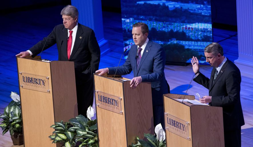 Republican gubernatorial candidate Ed Gillespie, right, gestures as Corey Stewart, center, and State Sen. Frank Wagner, left, listens during a debate at Liberty University in Lynchburg, Va., Thursday, April 13, 2017. (AP Photo/Steve Helber)