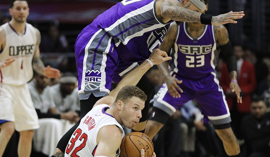 Los Angeles Clippers' Blake Griffin, bottom, grabs a loose ball against Sacramento Kings' Willie Cauley-Stein during the first half of an NBA basketball game Wednesday, April 12, 2017, in Los Angeles. (AP Photo/Jae C. Hong)