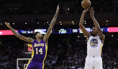 Golden State Warriors' Kevin Durant (35) shoots over Los Angeles Lakers' Brandon Ingram (14) during the second half of an NBA basketball game Wednesday, April 12, 2017, in Oakland, Calif. (AP Photo/Marcio Jose Sanchez)