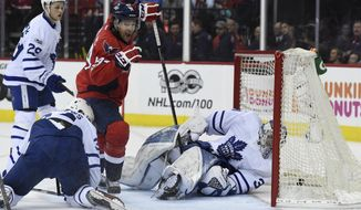 Washington Capitals right wing Justin Williams (14) scores against Washington Capitals goalie Philipp Grubauer (31) as William Nylander (29) and center Auston Matthews (34) watch during the second period in Game 1 of an NHL Stanley Cup first round playoff series in Washington, Thursday, April 13, 2017. (AP Photo/Molly Riley)