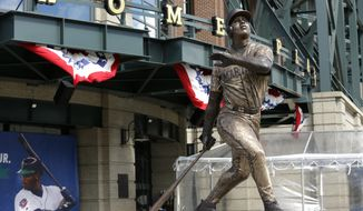 A statue of Seattle Mariners Hall of Famer Ken Griffey Jr. stands in front of the home plate entrance to Safeco Field, Thursday, April 13, 2017, in Seattle. (AP Photo/Ted S. Warren)
