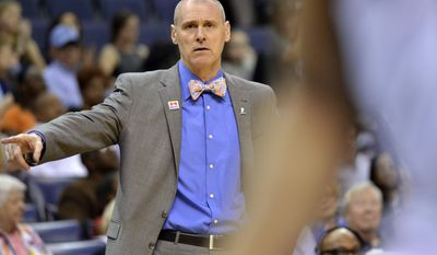 Dallas Mavericks head coach Rick Carlisle gestures from the sideline in the second half of an NBA basketball game against the Memphis Grizzlies Wednesday, April 12, 2017, in Memphis, Tenn. (AP Photo/Brandon Dill)