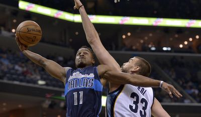 Dallas Mavericks guard Yogi Ferrell (11) shoots against Memphis Grizzlies center Marc Gasol (33) in the first half of an NBA basketball game Wednesday, April 12, 2017, in Memphis, Tenn. (AP Photo/Brandon Dill)