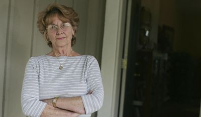 In this 2011 photo Joann Davis of Lake Elsinore, Calif., poses for a photo. Davis was interrogated by NASA agents after they seized a valuable Apollo 11 lunar rock that she was trying to sell back to NASA. On Thursday, April 13, 2017, a federal appeals court said that a federal agent unnecessarily degraded Davis when he interrogated her for nearly two hours in 2011 after seizing a moon rock she said her late husband had received from astronaut Neil Armstrong. (Sarah Burge/The Press-Enterprise via AP)