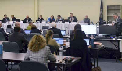 William Quinlan, far right, president of Eversource's New Hampshire operations, speaks during a hearing by the state's Site Evaluation Committee for the Northern Pass project Thursday, April 13, 2017, in Concord, N.H. The project calls for building a 192-mile transmission line from Pittsburg to Deerfield, to carry Hydro-Quebec power to southern New England markets. (AP Photo/Michael Casey)