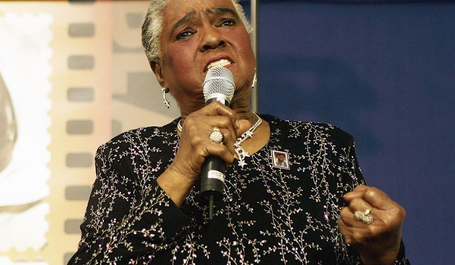 "FILE - In this Jan. 25, 2006 file photo, jazz and blues singer Linda Hopkins performs during a ceremony unveiling a new postage stamp honoring Hattie McDaniel, the first African American to win an Academy Award for her role in ""Gone With the Wind,""in Beverly Hills, Calif. Hopkins, who won a Tony Award in 1972 for the musical ""Inner City,"" has died Monday, April 10, 2017, in Milwaukee, Wis., according to her great-niece Hazel Lindsey. She was 92. (AP Photo/Damian Dovarganes, File)"