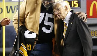 FILE--This Nov. 2, 2014 file photo shows Pittsburgh Steelers Pro Football Hall of Famer Joe Greene, left, hugging Steelers chairman Dan Rooney following a ceremony to retire Greene's jersey number 75 at half time of an NFL football game between the Pittsburgh Steelers and the Baltimore Ravens, in Pittsburgh. The Steelers announced that Mr. Rooney died Thursday, April 13, 2017. He was 84. (AP Photo/Gene J. Puskar/File)