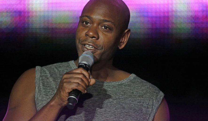 FILE - This Sunday, July 6, 2014 file photo, Dave Chappelle performs at the Essence Festival in New Orleans. Chappelle teamed up with John Mayer to remember late comedian Charlie Murphy at Mayer's concert in Columbus, Ohio, on April 12, 2017. Murphy died the same day. (AP Photo/Gerald Herbert, File)