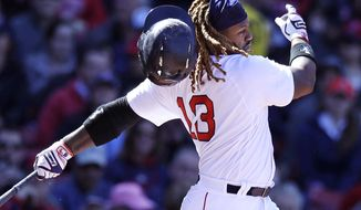 Boston Red Sox's Hanley Ramirez loses his batting helmet on a strike out during the fourth inning of a baseball game against the Pittsburgh Pirates at Fenway Park in Boston, Thursday, April 13, 2017. (AP Photo/Charles Krupa)