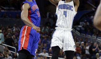 Orlando Magic's Elfrid Payton (4) shoots over Detroit Pistons' Ish Smith during the second half of an NBA basketball game, Wednesday, April 12, 2017, in Orlando, Fla. Orlando won 113-109. (AP Photo/John Raoux)