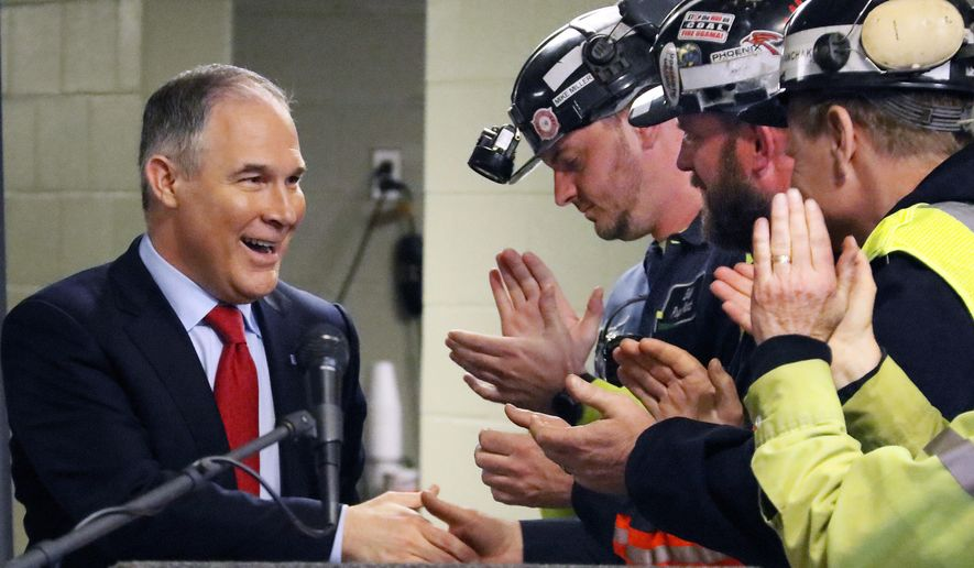 U.S. Environmental Protection Agency Administrator Scott Pruitt, left, shakes hands with coal miners during a visit to Consol Pennsylvania Coal Company's Harvey Mine in Sycamore, Pa., Thursday, April 13, 2017. (AP Photo/Gene J. Puskar)