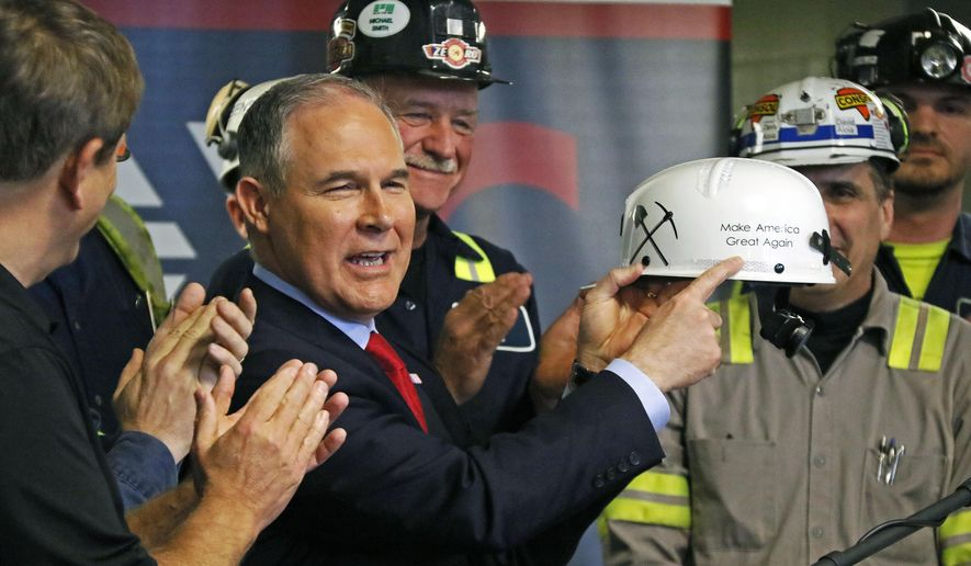 U.S. Environmental Protection Agency Administrator Scott Pruitt holds up a hardhat he was given during a visit to Consol Pennsylvania Coal Company's Harvey Mine in Sycamore, Pa., Thursday, April 13, 2017. (AP Photo/Gene J. Puskar)