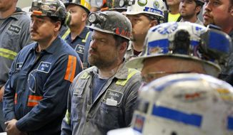 A group of coal miners listen to U.S. Environmental Protection Agency Administrator Scott Pruitt during his visit to Consol Pennsylvania Coal Company's Harvey Mine in Sycamore, Pa., Thursday, April 13, 2017. (AP Photo/Gene J. Puskar)