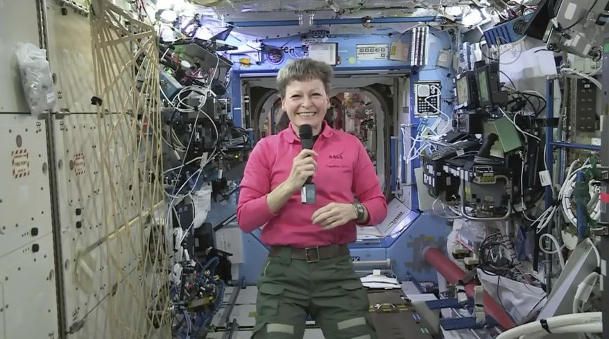 In this Thursday, April 13, 2017 image from video made available by NASA, astronaut Peggy Whitson speaks during an interview aboard the International Space Station. The commander of the ISS says that five months into her current mission, she's still not bored. At 57, she's the oldest woman to fly in space and is on the verge of setting a U.S. record for most accumulated time in space. (NASA via AP)