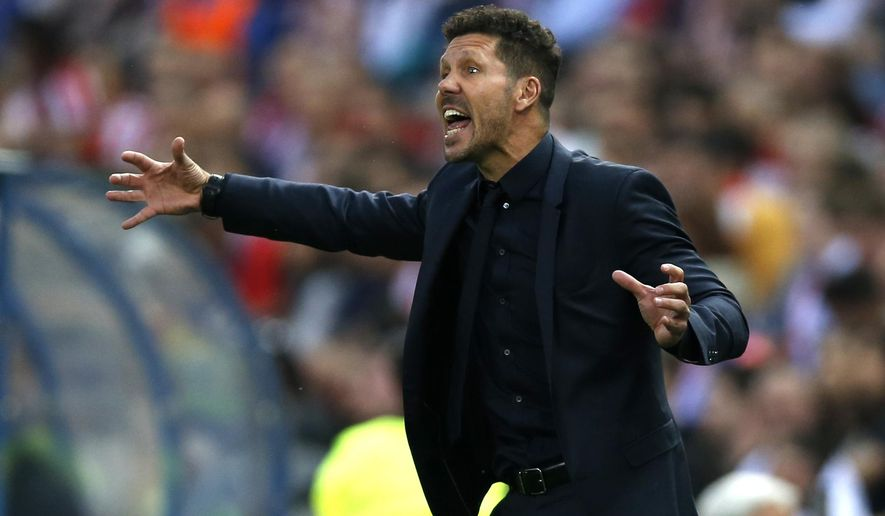 Atletico's head coach Diego Simeone gestures during the Champions League quarterfinal first leg soccer match between Atletico Madrid and Leicester City at the Vicente Calderon stadium in Madrid, Wednesday, April 12, 2017. (AP Photo/Francisco Seco)